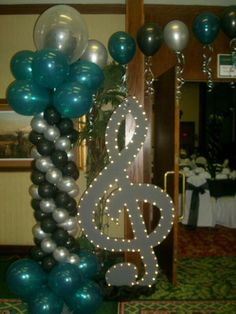 Mom to Caitlin - I know the colors are wrong...but how do you like the giant music symbol? sic themed wedding decor | Pinned by Brooklyn Hite
