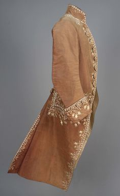 Court coat, 18th century. Brown silk faille lavishly decorated with floral embroidery in white and pastel tones, lined in ivory silk and linen, embroidered self buttons.
