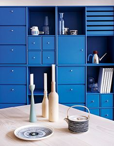Blue shelving. office space or guest room? maybe even living room nook area? I could dress it up with nice pictures and vases.