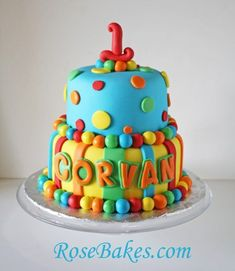 Bold, Bright Stripes & Polka Dots 1st Birthday Cake.  Click over for lots more pics and details!