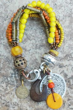 Tahiti Charm Bracelet: Tribal Orange and Yellow Glass, Horn and Exotic Metals Charm Bracelet