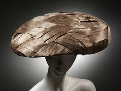 Hat      Place of origin:      London, England (made)     Date:      ca. 1955 (made)     Artist/Maker:      Simone Mirman, born 1912 (milliner)