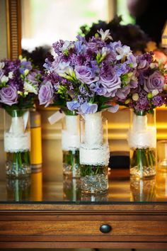 Wedding centerpieces with lace wrap.