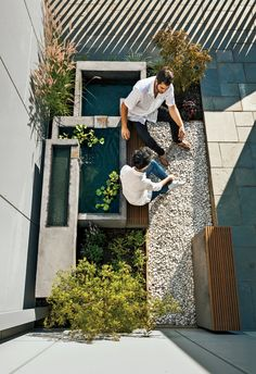 Secret Garden - Photo 1 of 11 - Höweler + Yoon squeezed high-design landscape elements, like a fountain and built-in seating, into a small space. Modern Landscaping, Backyard Landscaping, Backyard Ponds, Landscaping Ideas, Backyard Waterfalls, Garden Ponds, Koi Ponds, Backyard Ideas, Small Gardens