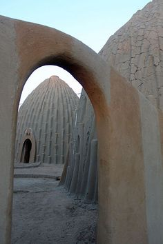 Africa | Moussgoum obus / obi structures in Pouss, northern Cameroon near the border with Chad