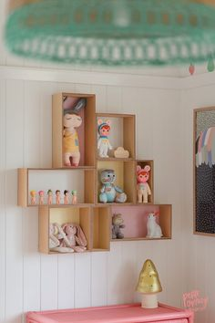 Shadow boxes transform a plain wall into a decorative feature. Styling and photo by Petite Vintage Interiors. theguideonline.com.au