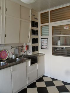Love this original kitchen from 1954! The built-in cupboards, the wooden counters, the floor!