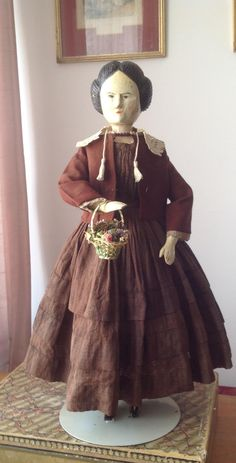 This is an unusual German wooden doll dating from 1850s.  She is 20 inches tall.  She has a very well carved face with intricately carved hairstyle.