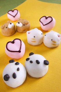So cute!! I guess they're fruit dipped in yogurt or something. then icing for the faces and hearts?