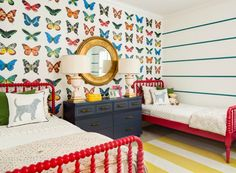 J and J Design Group reveals a colorful butterfly shared girls room and gives their advice for successfully moving your kids into the same bedroom.