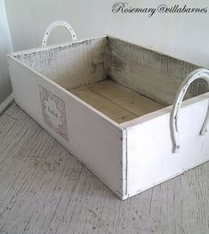 Build a little box, use horseshoes as handles, paint distressed white. Sweet and easy and a great use for all that scrap wood that hubby keeps threatening to throw in the burn pile!! villabarnes