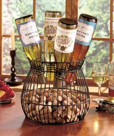 Store up to 4 bottles of wine, as well as your cork collection, in this decorative Cork and Wine Bottle Holder. It's ideal for an eye-catching display in the dining room or kitchen. Fill the generously sized bowl with corks from the bottles you have