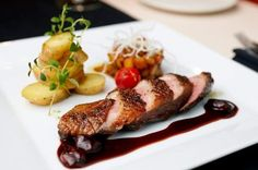 Crispy Duck Breast with Cherry Port Sauce.