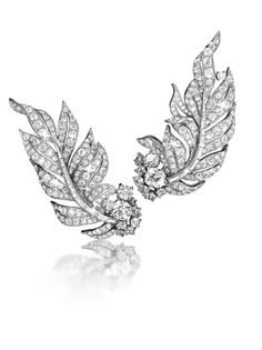 """Diamond and platinum """"Feather"""" earclips, originally made in 1956 for Mrs Vincent Astor."""