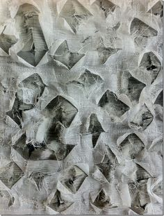 Daniela Maschera : For this second interpretation in fabric I made a sandwich of a printed cotton, grey lining, curtain fabric and tarlatan, stitched them all together with randomly wavy lines and cut irregular diamond areas to reveal the background layer in different ways. Technique: wadded quilting.