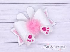 These cute bows are perfect for your little bunny this Easter. They are made using a white faux suede fabric and complete with ears, feet and an adorable fluffy tail!   The bows are approximately 3.5 inches long, they are absolutely stunning and need to be seen. The hair bow is listed as being mounted on a clip, howeve