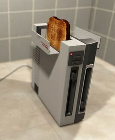 """The """"NES Toaster"""" is an excellent concept of retro gaming toaster designed by MyBurningEyes which will probably please all fans of the Nintendo Entertainment System! Unfortunately this gadget is only a concept!"""