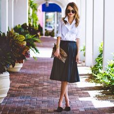 "Click the photo to shop the look | Taylor Morgan of Little Blonde Book wearing a TopShop faux leather pleated midi-skirt, J.Crew white shirt, Clare V leopard foldover clutch, bauble bar pearl studs, Kendra Scott ""Roni"" cuff,  Vince black pumps, and Karen Walker sunglasses 