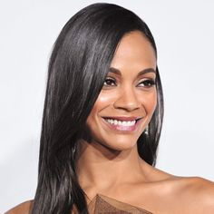 """10 Ways to Glossy Hair   Flat-Iron It; Ever notice how straight hair looks almost incandescent when it catches the light? That extra-glossy effect isn't an illusion, says dermatologist Jeannette Graf. """"Flat-ironing helps ruffled hair cuticles lie flat, which creates more surface area to reflect light,"""" she explains. Just be sure not to fry your strands: Only iron bone-dry hair, use a gliding motion, and choose ceramic plat"""