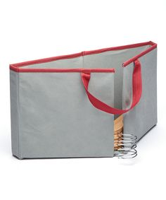 Avoid tangled hangers by storing your extras in this handy keeper that's designed to hold wood, plastic and wire hangers. It's great for transporting unused hangers and it folds flat when not in use for your storage convenience.