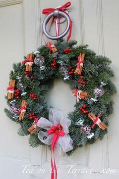 Kat Weatherill's Christmas wreath on a Farrow & Ball Cooking Apple Green door!
