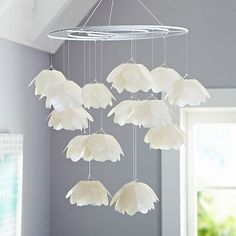 I could totally make that out of wire wreath frames and tissue paper flowers
