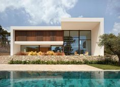 Louvered Shutters, Large Bookcase, Double Sided Fireplace, Compact House, Infinity Edge Pool, Weathering Steel, Modern Buildings, Ground Floor, Interior Architecture
