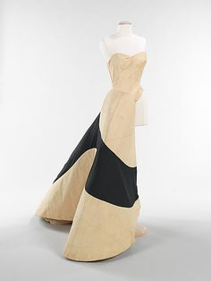 Another half-sewn muslin, this of an iconic Charles James gown shows its construction is among the most complicated of all his dresses. This half-sewn muslin shows the design and construction process; it is similar to having an architect's model approaching the finished product.