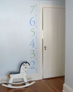 Maybe a height chart for all of the kids in the entry way... With some stickies with their names!