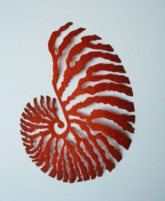 Australian artist Meredith Woolnough creates elaborate embroideries that mimic delicate forms of nature like leaves and coral. Woolnough uses a special embroidery technique that involves a domestic sewing machine and a base cloth that dissolves in water after the piece is complete leaving just the skeleton. In a way, her process also mimics the natural process of leaves dying and drying up which, in turn, become the subject of her work.