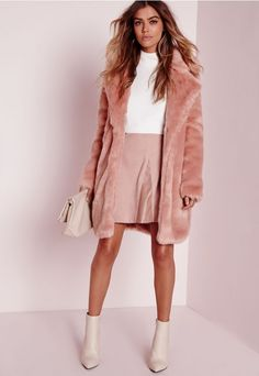 Play up to your feminine side this season in this totally chic faux fur pink coat. In a luxe longline style this beaut with oversized lapels and hook and eye fastening this coat is our current obsession here at Missguided.