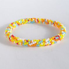 Roll On Bracelet  White Orange Yellow Blue Red by CharmedGifts