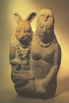 Figura Maya con un conejo.