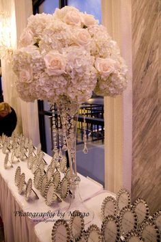 White hydrangea and rose centerpiece with hanging crystals.