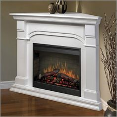 I want a corner fireplace in the (probably far) future family room. I can imagine the stockings hanging now ...