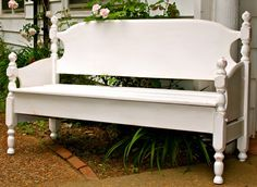 Build a Garden Bench from a Bed  What can you do with a beat up old bed frame that has a headboard and footboard? Why build a bench of course! This can probably be adapted to add some storage under the seat too.