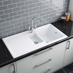 This contemporary Reginox White Ceramic 1.5 Bowl Kitchen Sink includes chrome wastes and overflow. ● L1000mm x W520mm x D180mm ● Sink Material - Ceramic ● Finish – Gloss White ● 10 YEAR WARRANTY  £169.95