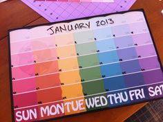 """DIY Paint Chip Calendar. I made this for my fridge in about an hour.  - 11x17"""" Format frame (Hobby Lobby) - 1"""" repositionable letters (Hobby Lobby) - double sided tape - 7 paint chips (Sherwin Williams) - 3M Command picture hanging strips"""