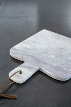 Our marble cheese platter is the ultimate accessory for luxury entertaining. Beautiful white and grey marble with an added handle is perfect for sophisticated serving. Ideal for displaying the finest