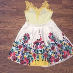 Brand new never worn Cute summer dress! A light yellow top with darker yellow straps really cute floral design on bottom. I ordered a size large but it was a little too big, I'm usually a medium. Dresses Mini