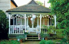 Veranda with bunting...Full details on Modern Country Style blog: Outdoor Living by Selina Lake: Book Review