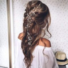 A nice simple hair do with flowers Very romantic