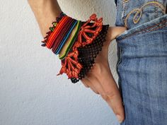 https://flic.kr/p/p6tzjo   Castilleja hispida: beaded bracelet with green, teal blue, orange, red and burgundy seed beads, persimmon and black crochet lace by irregular expressions
