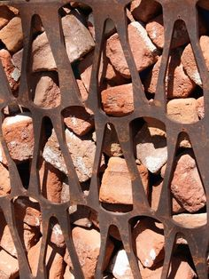 Gabion wall of recycled broken brick, cor-ten patterned retaining screen. Gabion Fence, Gabion Wall, Fence Planters, Bamboo Fence, Metal Facade, Backyard Fences, Garden Fencing, Fence Landscaping, Pool Fence