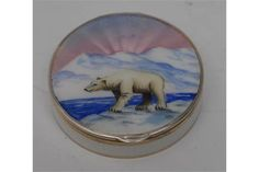 A Norwegian silver and enamel lady's circular compact, by Gustav Gaudernack, hinged cover painted