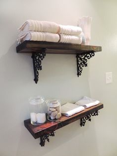2x8s, wood stain, and $7 iron brackets from Hobby Lobby = easy, custom shelves