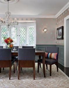 The dining-room in this traditional Tudor-style home in Toronto has its period wainscoting painted in Farrow & Ball Stone Blue, a grey-tone shade that brings a fashion feel to the heritage home. Sara Bederman Design added decorative wainscoting below and a metallic smoked oyster wallpaper above. Painting the panelling, baseboard and chair rail in the same dark tone-on-tone shade gives the room a grounded, after-dark aesthetic. sarabederman.com