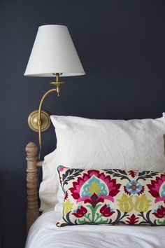 Benjamin Moore Hale Navy paint Pottery Barn Weston Arc Brass Sconce, Waverly Santa Maria Desert Flower fabric, stripped Jenny Lind bed