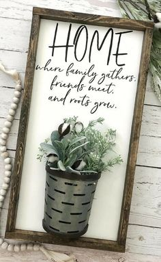 Such a unique farmhouse sign with the galvanized metal vase. Home- where family gathers, friends meet and roots grow. #farmhouse #ad #rustic #housewarming #giftidea