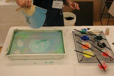 Candace Thayer-Coe shows the suminagashi technique by Alcuin Society, via Flickr